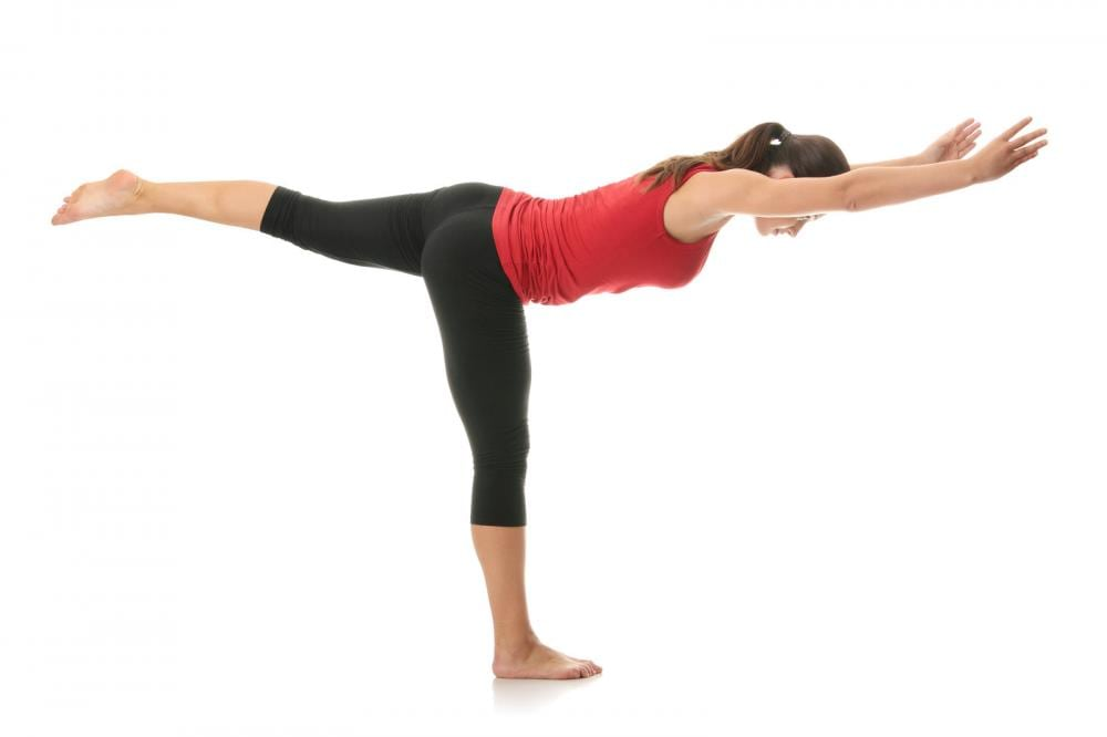 dame utfører yoga-øvelse
